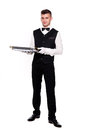 A young boy waiter with a tray isolated background and clipping path Stock Photography