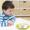 Young boy waiting to eat pikelets a waits tasty Stock Photos
