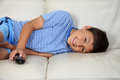 Young boy watching tv with remote control Royalty Free Stock Photo