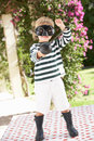 Young Boy Wearing Boots And Fancy Dress Costume Stock Image