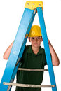 Young boy wearing hard hat looking ladder sweat beads can be seen his face hard construction work has been doing isolated white Stock Images