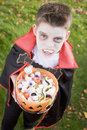 Young boy wearing vampire costume on Halloween Royalty Free Stock Image