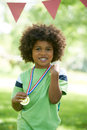 Young Boy Winning Medal At Sports Day Royalty Free Stock Photo