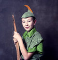 Young boy wooden bow robin hood costume Stock Image