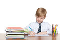 Young boy writes at the desk is sitting and write Royalty Free Stock Photography