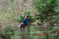 Young boy on zip line enjoying speed motion blur Stock Images