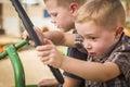 Young boys bawić się na starym ciągnikowym outside Obrazy Royalty Free