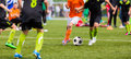Young boys children in uniforms playing youth soccer football ga game tournament horizontal sport background Royalty Free Stock Photography