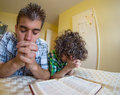 Young boys praying and praising god godly family exercising their faith at home Royalty Free Stock Images