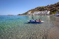 Young boys sailing in canoe near coast of Loutro town on Crete island, Greece Royalty Free Stock Photo