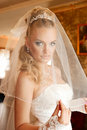 Young bride dresses veil Royalty Free Stock Photography