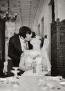 Young bride and groom wedding couple together in cafe black white happy newlywed at Stock Photos