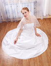 Young bride laughs while sitting on the floor in the house Stock Photo