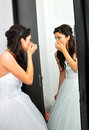 Young bride looking in mirror Stock Photography