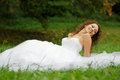 Young bride lying and smiling  Royalty Free Stock Photography