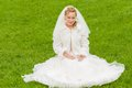 Young bride posing green grass wedding ceremony Royalty Free Stock Photo