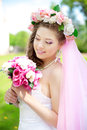 Young bride in a wreath of flowers beautiful on her head Stock Photos