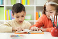 Young brother and sister learn how to read at home Stock Images