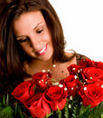 Young Brunette Admiring her Roses Stock Image