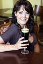Young brunette with beer glass in a restaurant Stock Photo