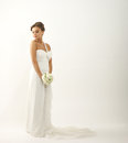 A young brunette bride in a white dress with roses Royalty Free Stock Images