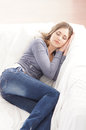 A young brunette Caucasian woman sleeping in jeans Stock Images