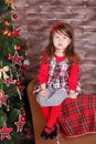 Young brunette dolly lady girl stylish dressed in red dress costume chequers check tartan skirt strap shoes smiling posing sitting Royalty Free Stock Photo