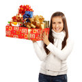 Young brunette girl holding gifts this image has attached release Stock Photo