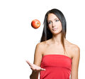 Young brunette juggling fresh apple. Stock Photo