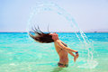 Young brunette jumping out of turquoise water of red sea egypt Stock Image
