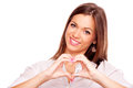 Young brunette make heart with fingers Photo stock