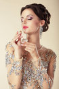 Young Brunette with Perfume Bottle. Fragrance Royalty Free Stock Photo