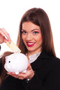 Young brunette put two hundred euro bill in the piggy bank on white background Royalty Free Stock Photos