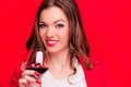 Young brunette with red wine beautiful holding glass of on the background Stock Images