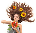Young brunette with scattered hairs and sunflower Royalty Free Stock Photo