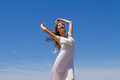 Young brunette in white flimsy dress enjoys the long haired girl pure angelic innocence enjoying sun on a fresh spring day Royalty Free Stock Photos