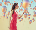 Young brunette woman among the balloons hundreds Stock Image
