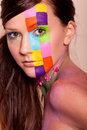 Young brunette woman with colorful makeup Stock Photos