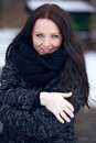 Young brunette woman in the freezing cold park portrait of a enjoying Royalty Free Stock Image