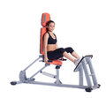 Young brunette woman on orange hydraulic exerciser Stock Photo