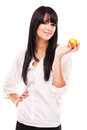 Young brunette woman with orange on white background studio photo of beautiful Stock Images