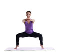 Young brunette woman posing in yoga on rubber mat Royalty Free Stock Image