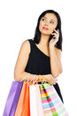 Young brunette woman with shopping bags isolated on white Royalty Free Stock Photo