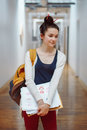 young brunette woman student, female drawing designer artist, in hall Royalty Free Stock Photo