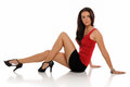 Young brunette woman wearing a short skirt Royalty Free Stock Image
