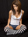 Young  brunette woman wearing striped stockings Stock Image