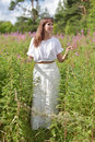 Young brunette woman in white dress Royalty Free Stock Photo
