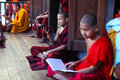 Young Buddhist monks studying at the monastery in Stock Photo