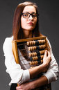 Young buisness woman with abacus wearing glasses Stock Images