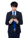 Young business asian man using his tablet Royalty Free Stock Photo